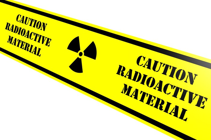 Yellow tape reads CAUTION RADIOACTIVE MATERIAL.