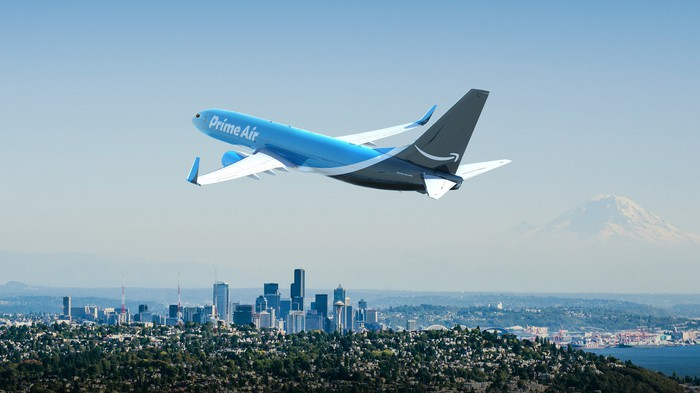 Amazon Prime Air plane flying above a city.