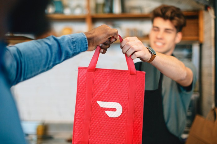 A Dasher accepts a DoorDash order.