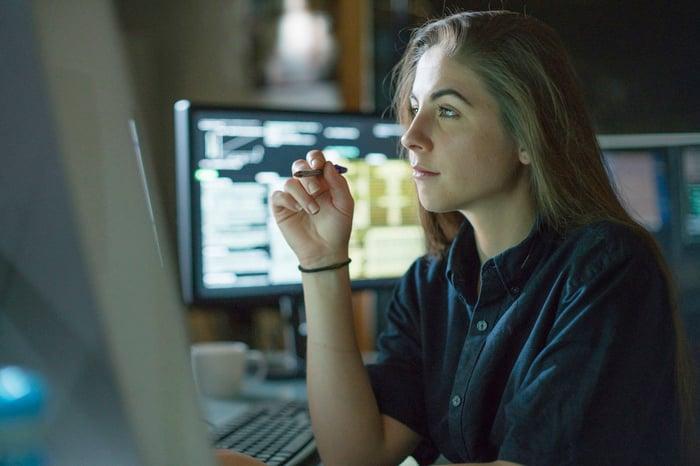 Woman focusing on a computer screen.