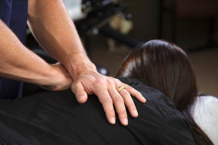 Patient receiving a chiropractic adjustment