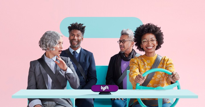 A Lyft driver and three well-dressed passengers in an imaginary Lyft car with a Lyft beacon on the dashboard.