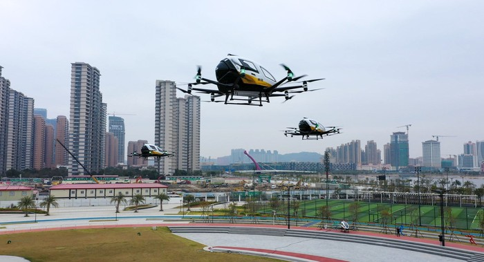 EHang EH216 AAVs in flight.