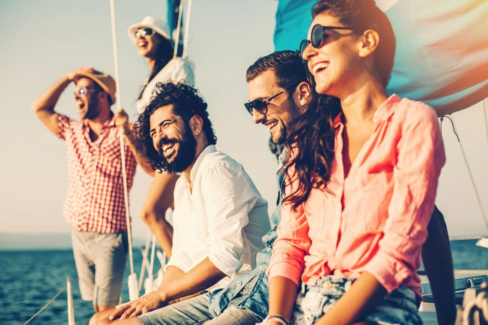 group of friends on board a yacht laughing