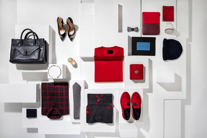 A handbag, shoes, and other fashion items on display.