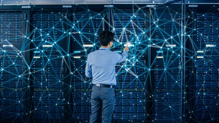 An IT professional checks a server.
