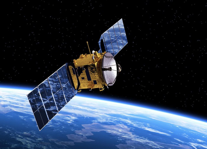 Satellite in orbit, with Earth below.