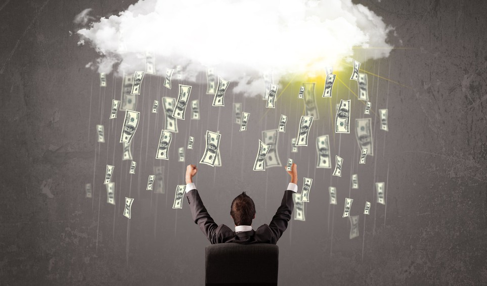 Business man in suit looking at cloud with falling $100 bills