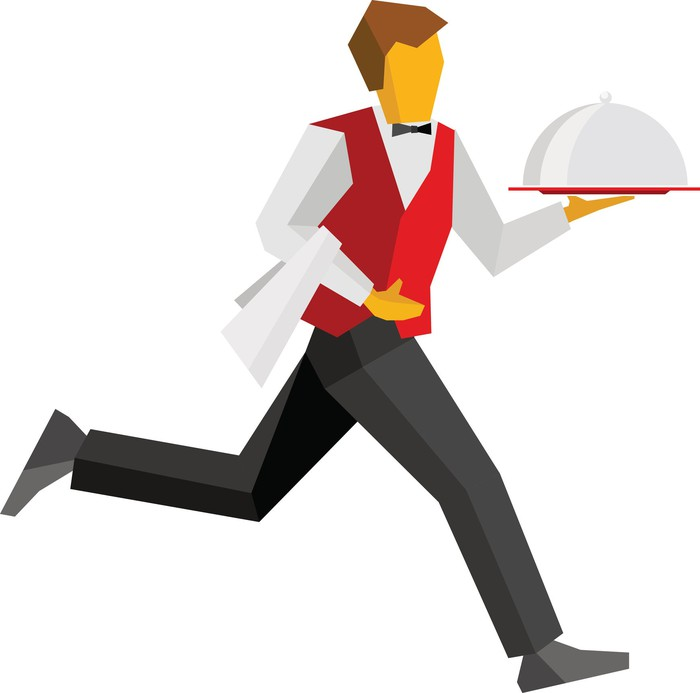 Waiter in red vest running with a covered dish of food.