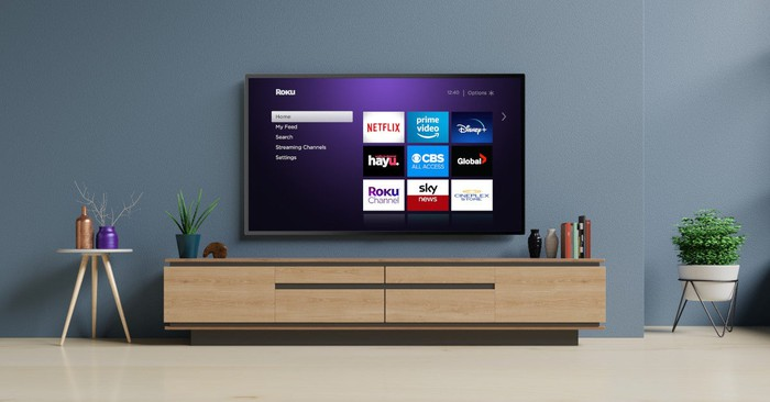 Roku TV mounted on a wall.