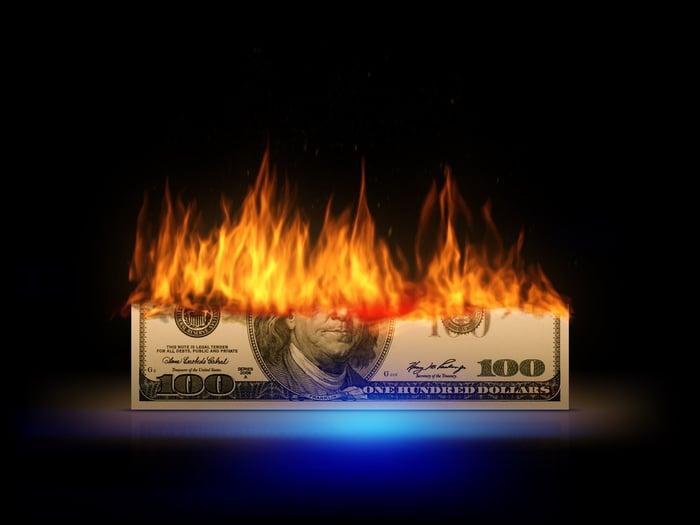 Hundred-dollar bill on fire.