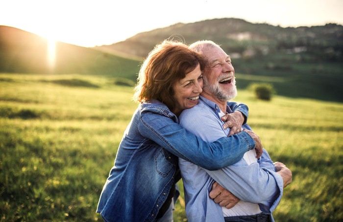 Older couple embracing outdoors