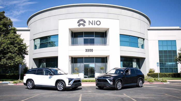 Two NIO ES8 electric SUVs parked in front of the company's California office.