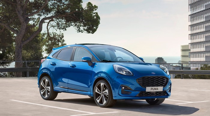 A blue Ford Puma, a small sporty SUV sold in Europe.