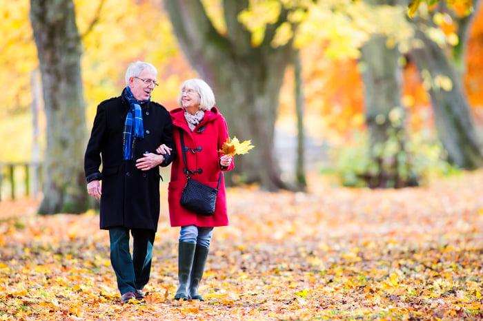 Senior couple enjoying an autumn walk.