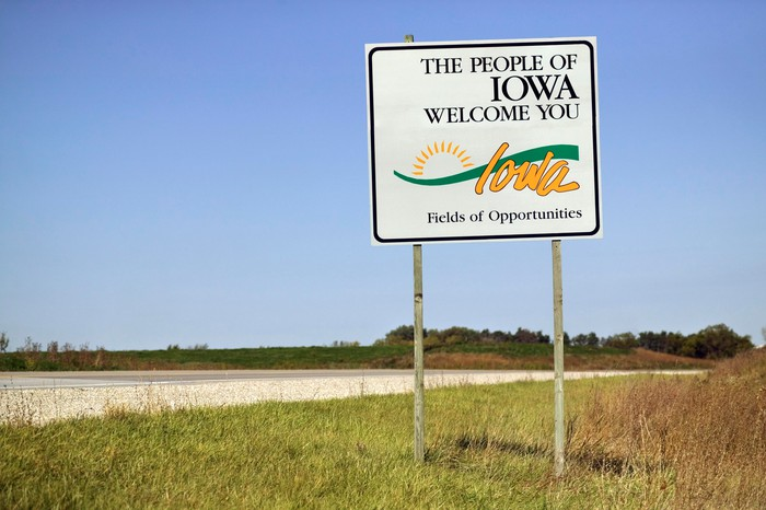 A welcome sign on the border of Iowa.