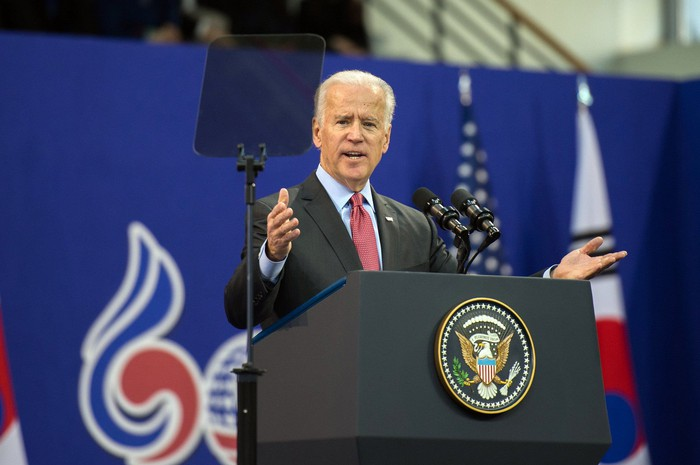 Joe Biden speaking behind a podium