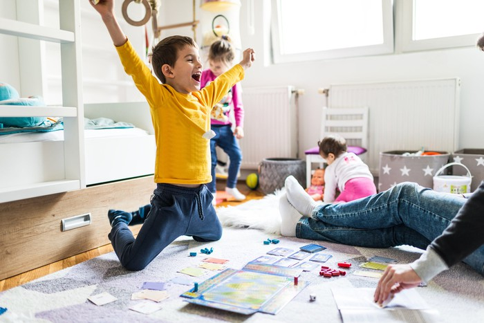 Child cheering over board game