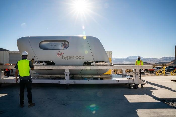 Virgin Hyperloop test pod on a platform.