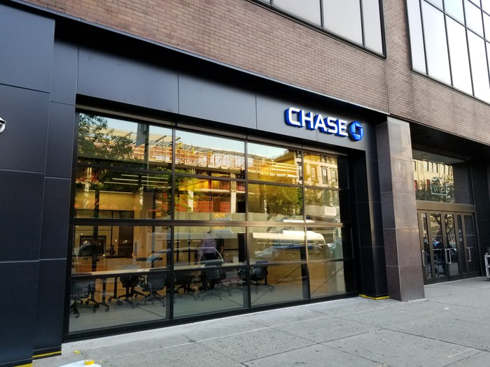 The exterior of a JPMorgan Chase branch on a city street