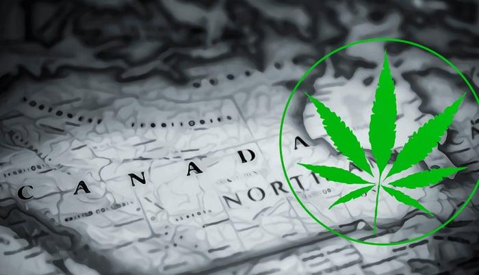 Marijuana leaf atop a map of Canada.