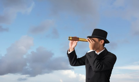 Business man with telescope