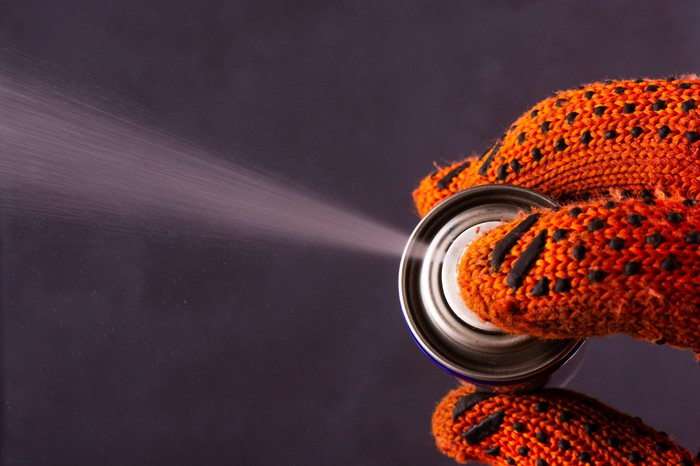 A lubricant being sprayed.