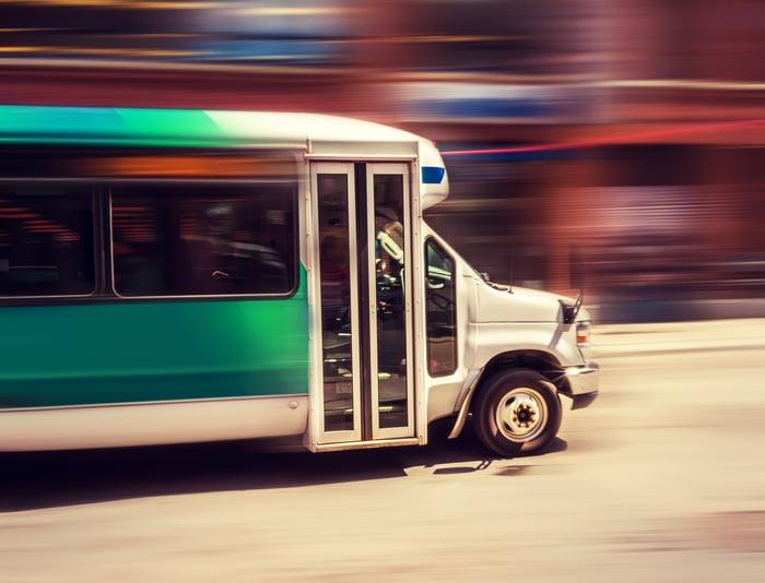 A shuttle bus driving