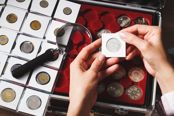 coin collector examining coins