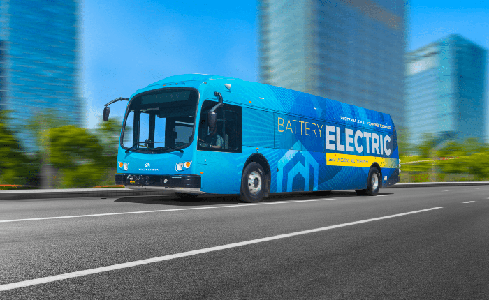 Proterra electric bus driving down the street