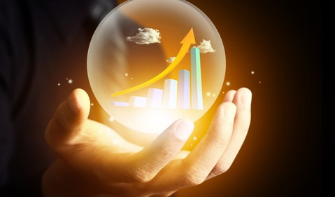 Crystal ball with stock chart going up