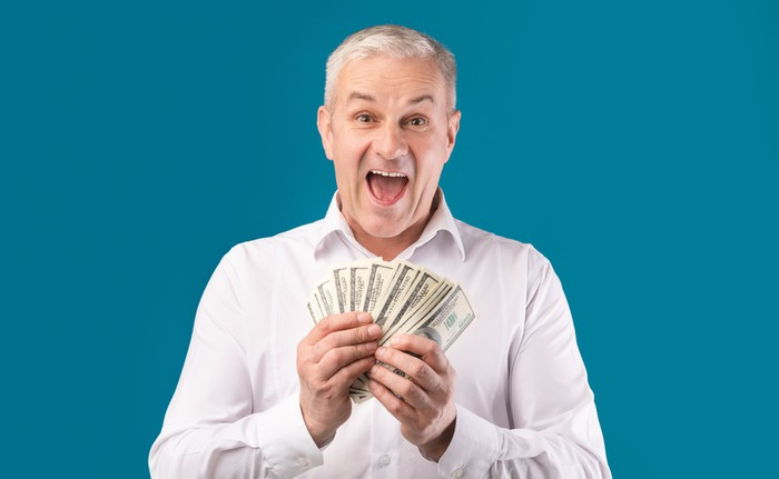 Excited man holding money in hand