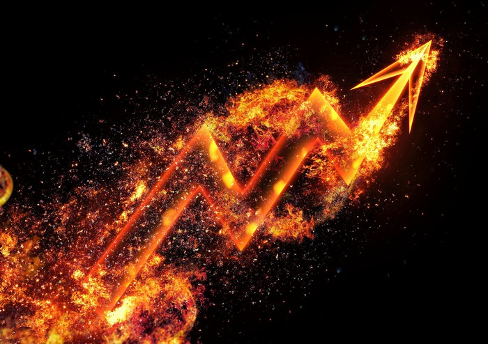 Upward arrow composed of fire and sparks.