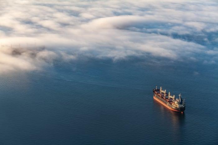 A container cargo ship at sea.