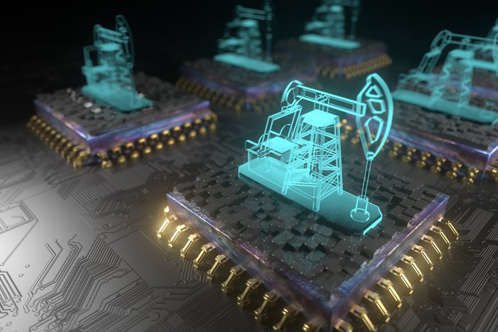 Oil pumpjacks on top of silicon chips illustrates an abstract bitcoin mining concept.