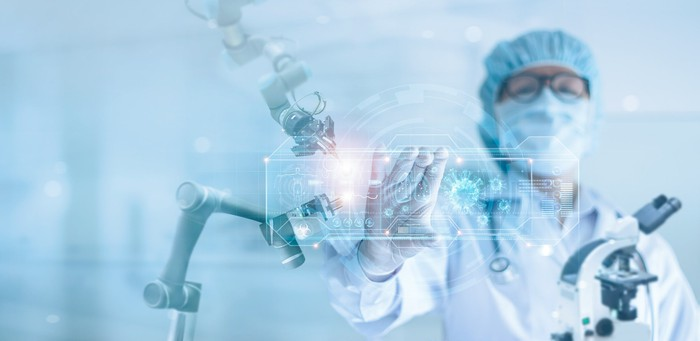 A doctor touches an interface for a surgical robot.