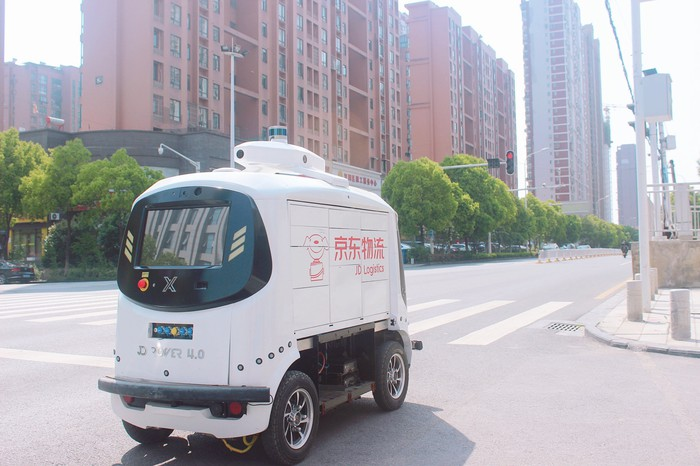 A JD delivery robot on the street.