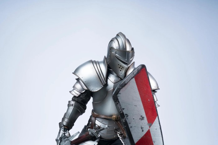 Suit of metal armor with a shield.
