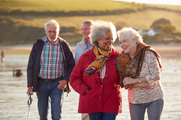 Seniors walking together by a lake