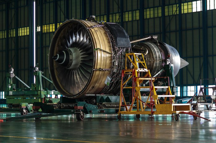 Aircraft engine under construction in a hangar.