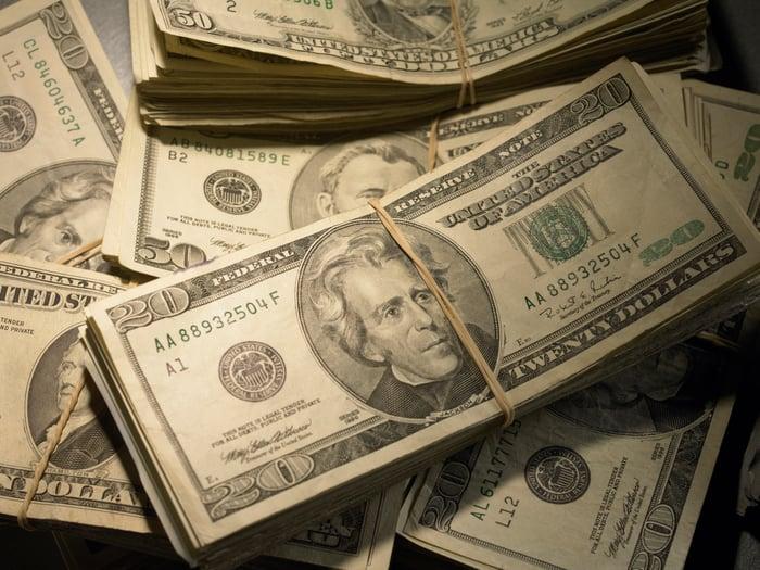 Bundles of cash in a pile.