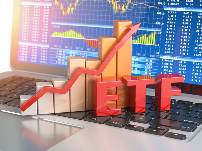 The letters ETF and a stock feverline sit on a laptop keyboard.