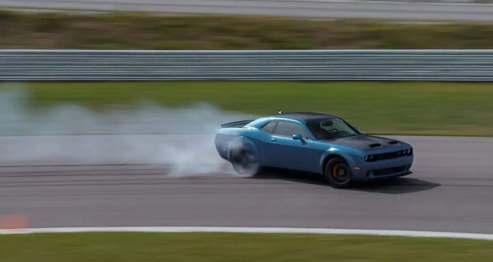 A Dodge Challenger SRT Hellcat Redeye being put through its paces on a track.