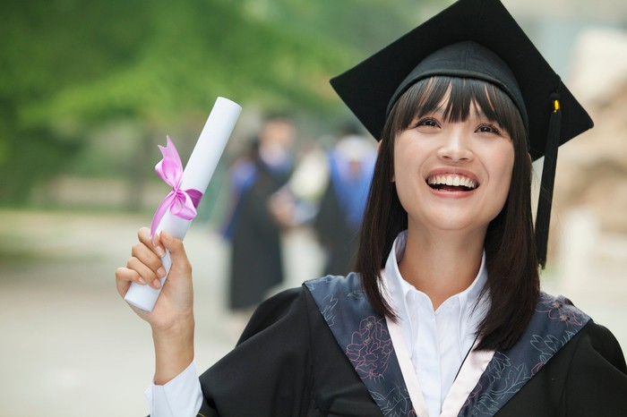 Happy woman holding diploma