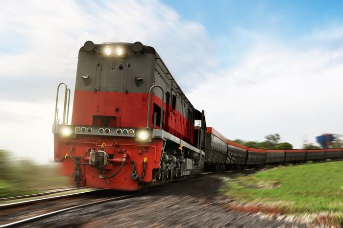 A freight train speeding down a track.