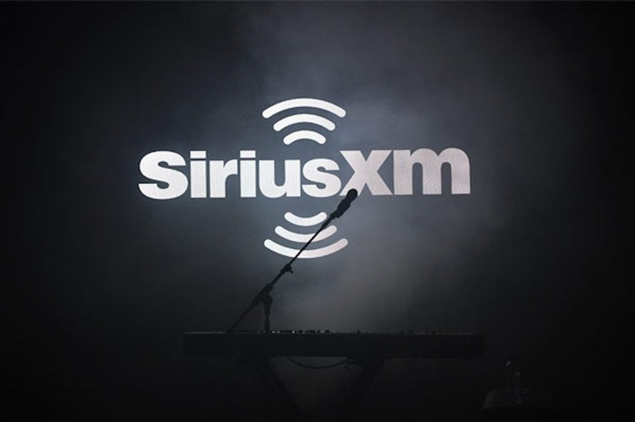 Sirius XM logo with microphone over a black background.