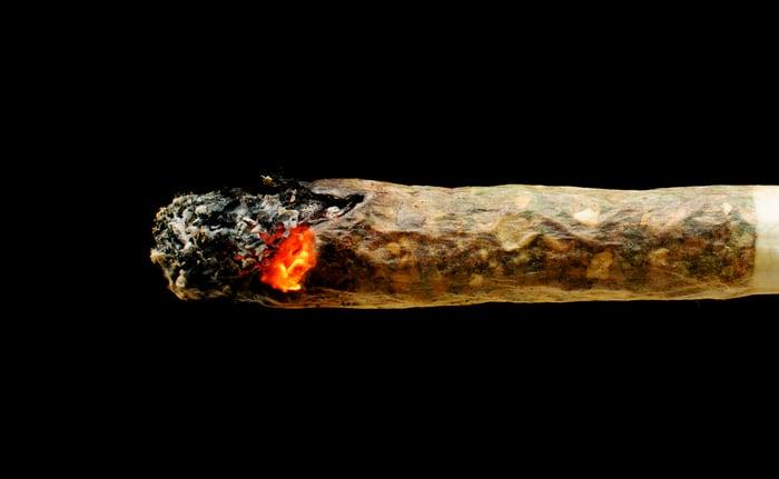 Burning red marijuana joint