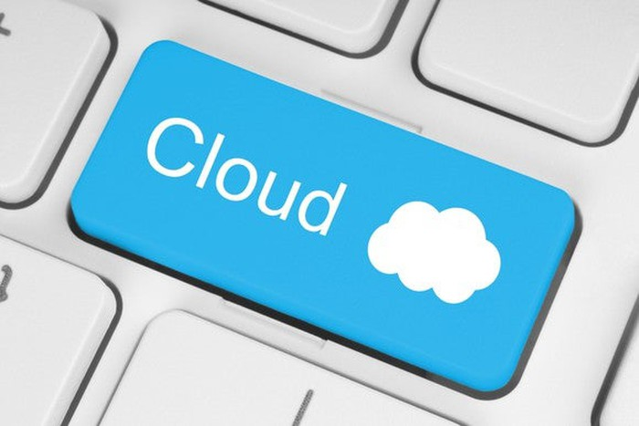 A blue key on a keyboard, with the world cloud written on it, and a white cloud drawn next to it.