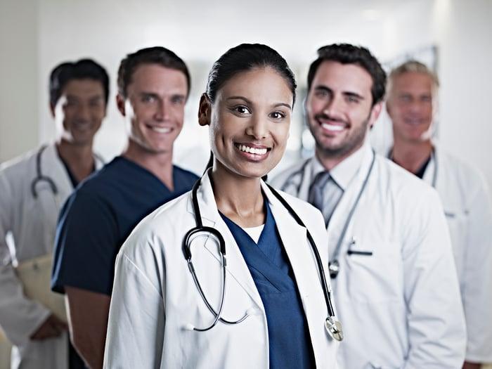 Five smiling doctors