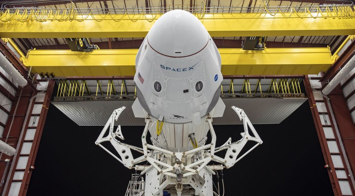 SpaceX Dragon Capsule emerging from a hangar.
